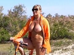 During her holidays in a nudistresort Chris sometimes did trips with her little bicycle. Of course she did it nude.